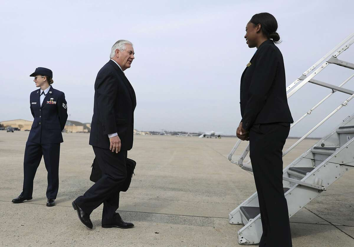 Secretary of State Rex Tillerson walks to board his plane at Andrews Air Force Base, Md., Wednesday, Feb. 22, 2017, before his departure to Mexico. President Donald Trump is sending his Tillerson and Homeland Security Secretary John Kelly to Mexico on a fence-mending mission made all the more challenging by the actual fence he wants to build on the southern border. (Carlos Barria via AP, Pool)