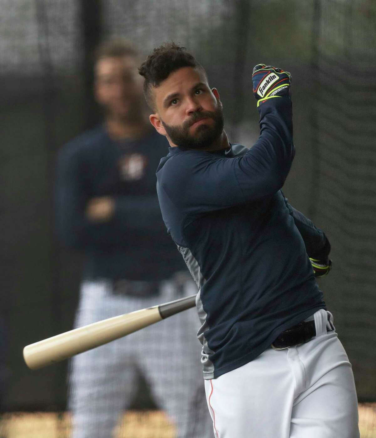 Houston Astros second baseman Jose Altuve (27) hits balls in the batting cage during spring training at The Ballpark of the Palm Beaches, in West Palm Beach, Florida, Wednesday, February 22, 2017.