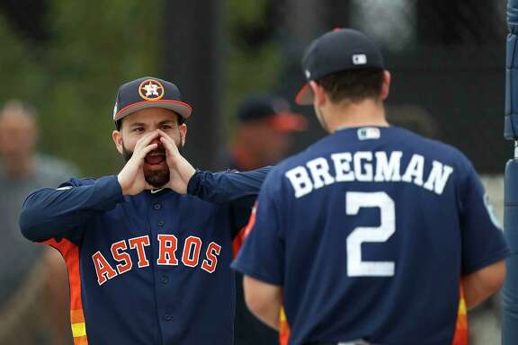 Houston Astros Jose Altuve (27) messes around with Alex Bregman (2) during spring training at The Ballpark of the Palm Beaches, in West Palm Beach, Florida, Wednesday, February 22, 2017.