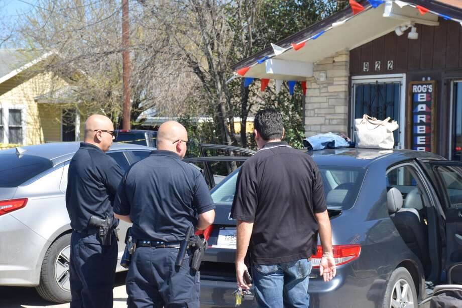"A suspect is in ""grave"" condition after he was shot at a motel near Loop 410 and Interstate 90 Wednesday, Feb. 22, 2017, after allegedly trying to rob a man at knife-point. Photo: Caleb Downs / San Antonio Express-News"