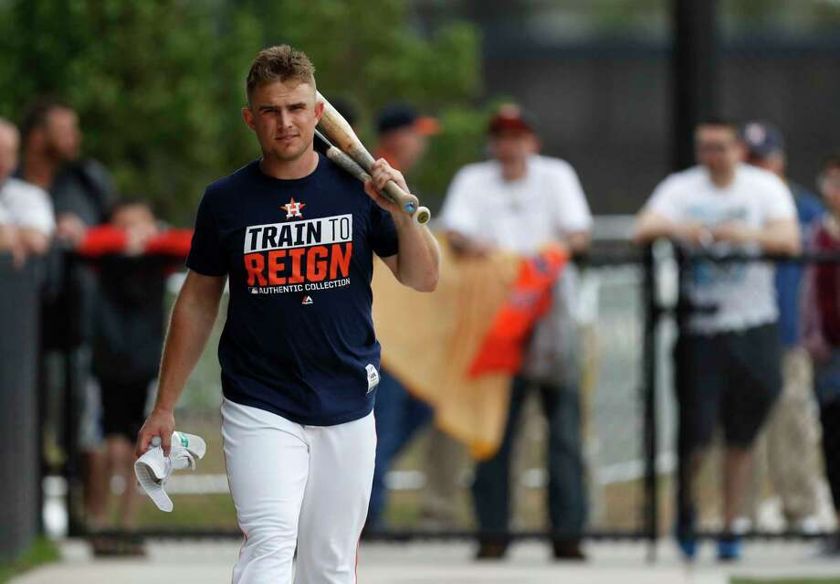 Houston Astros catcher Max Stassi walks back to the clubhouse after workouts during spring training at
