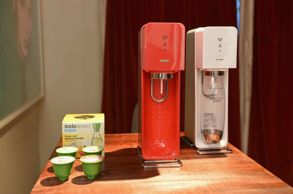 Two SodaStream machines are shown at a press event.