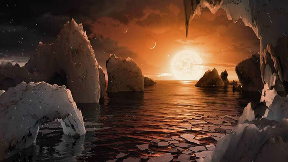 This artist's concept allows us to imagine what it would be like to stand on the surface of the exoplanet TRAPPIST-1f, located in the TRAPPIST-1 system in the constellation Aquarius. The stunning discovery of seven Earth-like planets orbiting a small star in our galaxy opens up the most promising hunting ground to date for life beyond our solar system, researchers said. All seven are within 20 percent of the size and mass of our own planet and almost certainly rocky, and three are ideally situated to harbour life-nurturing oceans of water, they reported in the journal Nature. Photo: NASA /JPL-Caltech /TNS / Los Angeles Times