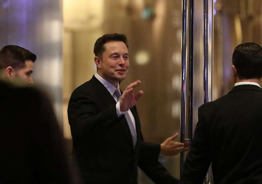Elon Musk, the co-founder and chief executive of electric carmaker Tesla, gestures during a ceremony in Dubai on February 13, 2017. The company said Tuesday that it built 50,067 cars in the second half of 2016 and delivered 47,073, whereas it had projected delivering 50,000 cars during that timeframe. Photo: KARIM SAHIB, AFP/Getty Images