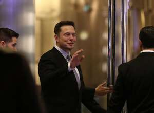 Elon Musk, the co-founder and chief executive of Electric carmaker Tesla, gestures during a ceremony in Dubai on February 13, 2017. Tesla announced the opening of a new Gulf headquarters in Dubai, aiming to conquer an oil-rich region better known for gas guzzlers than environmentally friendly motoring. / AFP PHOTO / KARIM SAHIBKARIM SAHIB/AFP/Getty Images