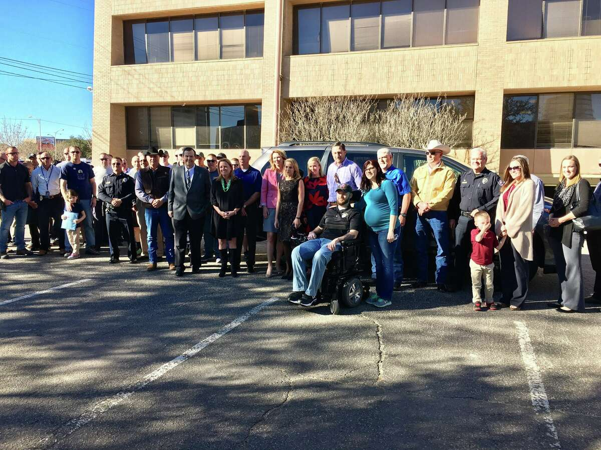 Representatives from four local oil companies stopped by today to welcome Officer Jake Churchwell back home to Midland after collectively providing him a wheelchair-accessible van.
