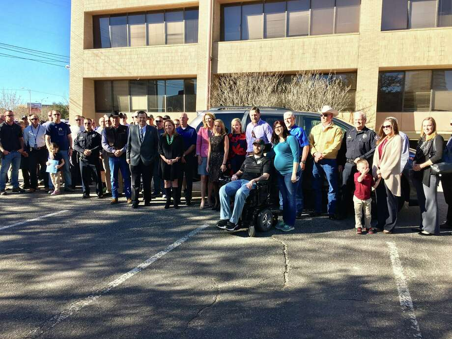 Representatives from four local oil companies stopped by today to welcome Officer Jake Churchwell back home to Midland after collectively providing him a wheelchair-accessible van. Photo: Midland Police Department/ Facebook