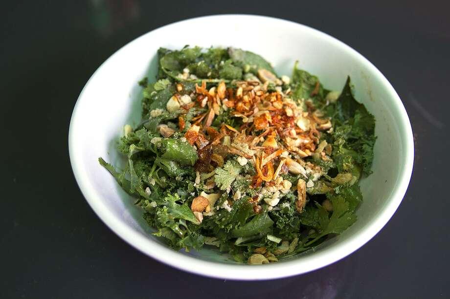 Tiger salad made of Burmese tea, kale, cilantro, green onion and nuoc cham Photo: Express-News File Photo / San Antonio Express-News