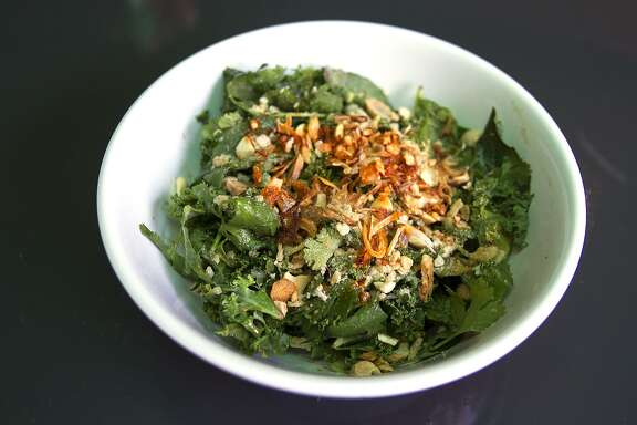 Tiger salad made of Burmese tea, kale, cilantro, green onion and nuoc cham