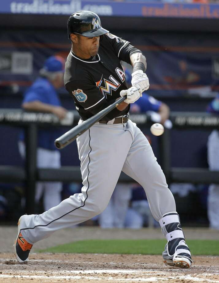 Miami Marlins' Kenny Wilson bats during the seventh inning of an exhibition spring training baseball game against the New York Mets Friday, March 4, 2016, in Port St. Lucie, Fla. (AP Photo/Jeff Roberson) Photo: Jeff Roberson, AP