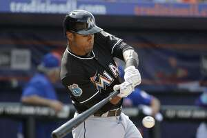 Miami Marlins' Kenny Wilson bats during the seventh inning of an exhibition spring training baseball game against the New York Mets Friday, March 4, 2016, in Port St. Lucie, Fla. (AP Photo/Jeff Roberson)