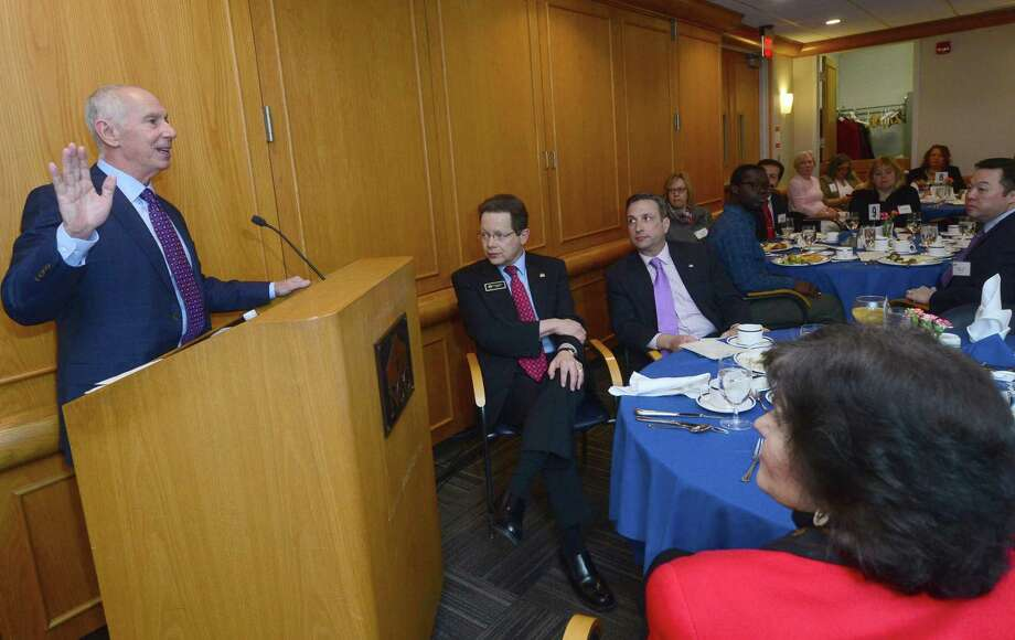 Mark Ojakian, President of Connecticut State Colleges and Universities, addresses the audience Wednesday morning, February 22, 2017,  for Norwalk Community College's annual Legislative Breakfast at the college in Norwalk, Conn. College leaders will made their case Wenesday to the state leaders on the need for adequate state funding. Budget cuts have in recent years reduced the college's staff and faculty, trimmed library hours and student services, and forced the college to do more with less. The event comes as Gov. Dannel P. Malloy proposed a 4 percent budget cut to the Connecticut State Colleges and Universities system budget and possible elimination of 430 jobs as a part of his biennial budget. Those cuts could have an enormous impact on Norwalk Community College and the entire city in general. Photo: Erik Trautmann / Hearst Connecticut Media / Norwalk Hour