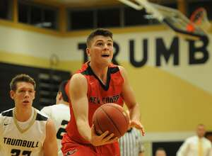 New Canaan's Tyler Sweeney drives to the basket during the Rams' FCIAC boys basketball game with Trumbull at Trumbull High School in Trumbull, Conn. on Monday, December 19, 2016.