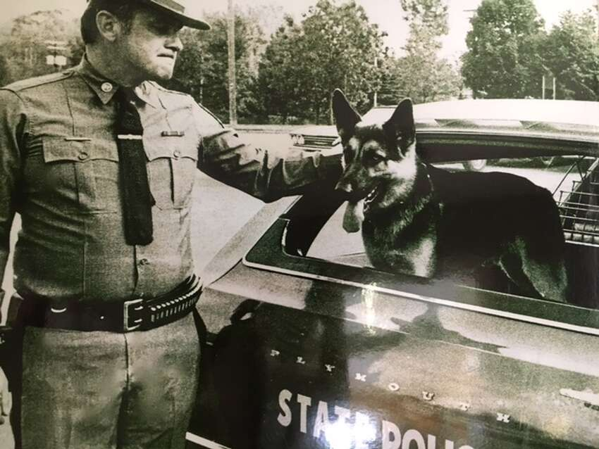 Former trooper James Keough poses with State Police dog Baretta. In 1976, Keough became one of the first three State Police canine handlers. (Altamont Public Library)