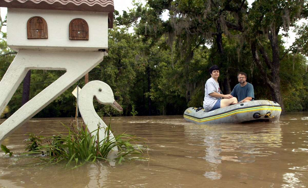Bernd Wuersig and his wife, Melany, float back to their home in a subdivision in Friendswood hit by Tropical Storm Allison in June 2001.
