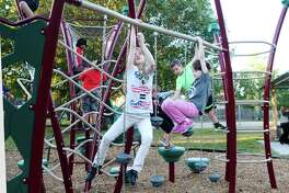 Crystal Fling, Kaylee Fling and Jacob McCree play on a structure in Wynfield Park. The Deer Park Parks and Recreation department has renovated seven parks in recent years, including Wynfield,