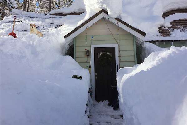 House in Truckee, Calif., piled high with snow