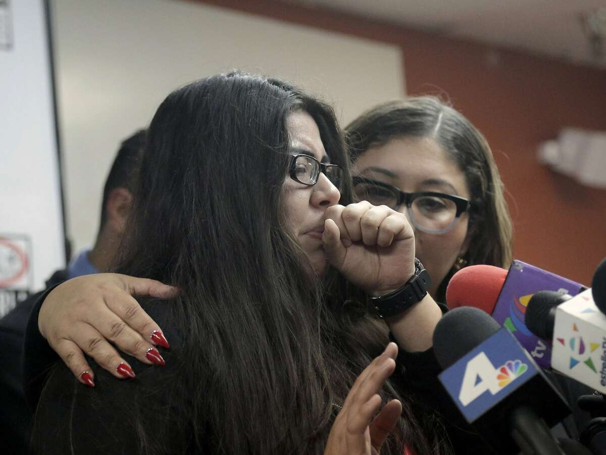 FILE - In this Friday, Feb. 10, 2017, file photo, Marlene Mosqueda, left, who's father, Manuel Mosqueda was arrested by the Immigration and Customs Enforcement agency early Friday morning to be deported, is comforted at a news conference by her attorney Karla Navarrette at The Coalition for Humane Immigrant Rights of Los Angeles (CHIRLA). Advocates began fielding calls Thursday, Feb. 9, from immigrants and their lawyers reporting raids at homes and businesses in the greater Los Angeles area. In one instance, agents showed up at the home of Manuel Mosqueda in the Los Angeles suburbs, looking to arrest an immigrant who wasn't there. In the process, they spoke with Manuel Mosqueda, arrested him and put him on a bus to Mexico � though lawyers were able to halt his deportation and bring him back. (AP Photo/Nick Ut, File)