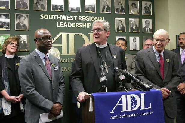 Bishop James Dixon, from left, of The Community Faith Church and Kingdom Builders Global Fellowship, Bishop Michael Rinehart, of Texas-Louisiana Gulf Coast Synod, Evangelical Lutheran Church in America, and Rabbi Emeritus Samuel Karff, of Congregation Beth Israel, deliver speeches against hate attacks to show solidarity to the Jewish community at Anti-Defamation League Wednesday, Feb. 22, 2017, in Houston.