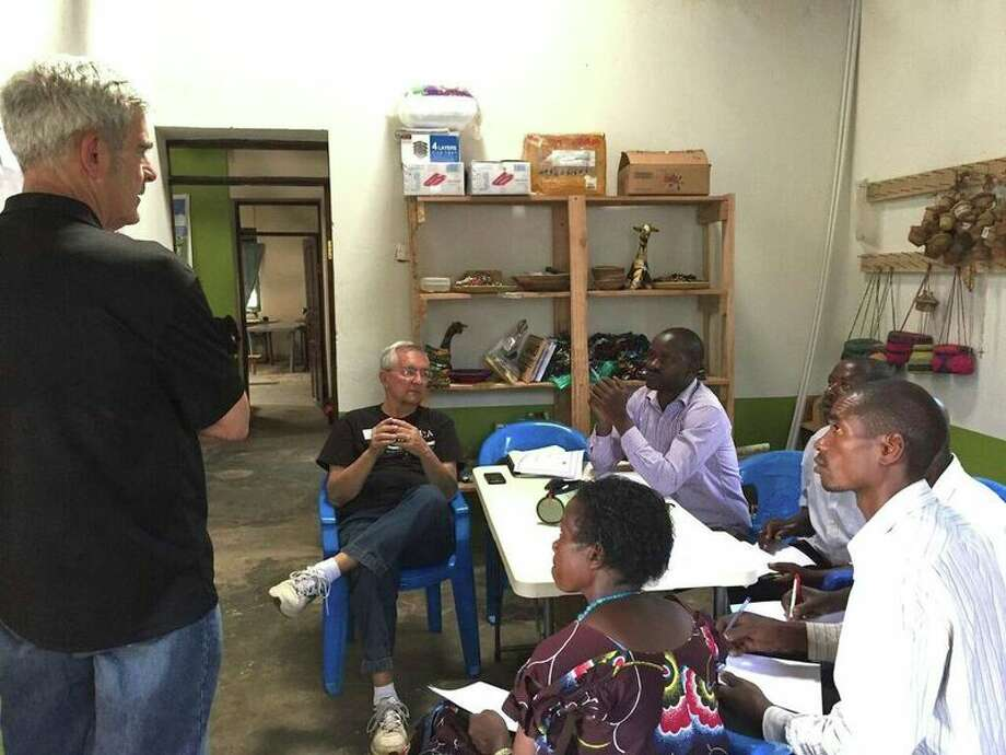 Photo provided Rotarian Tim Dyste leads a problem solving discussion with the Helping Agricultural New Development and Sustainability team on trace elements, fertilization and irrigation practices to improve crop yields.