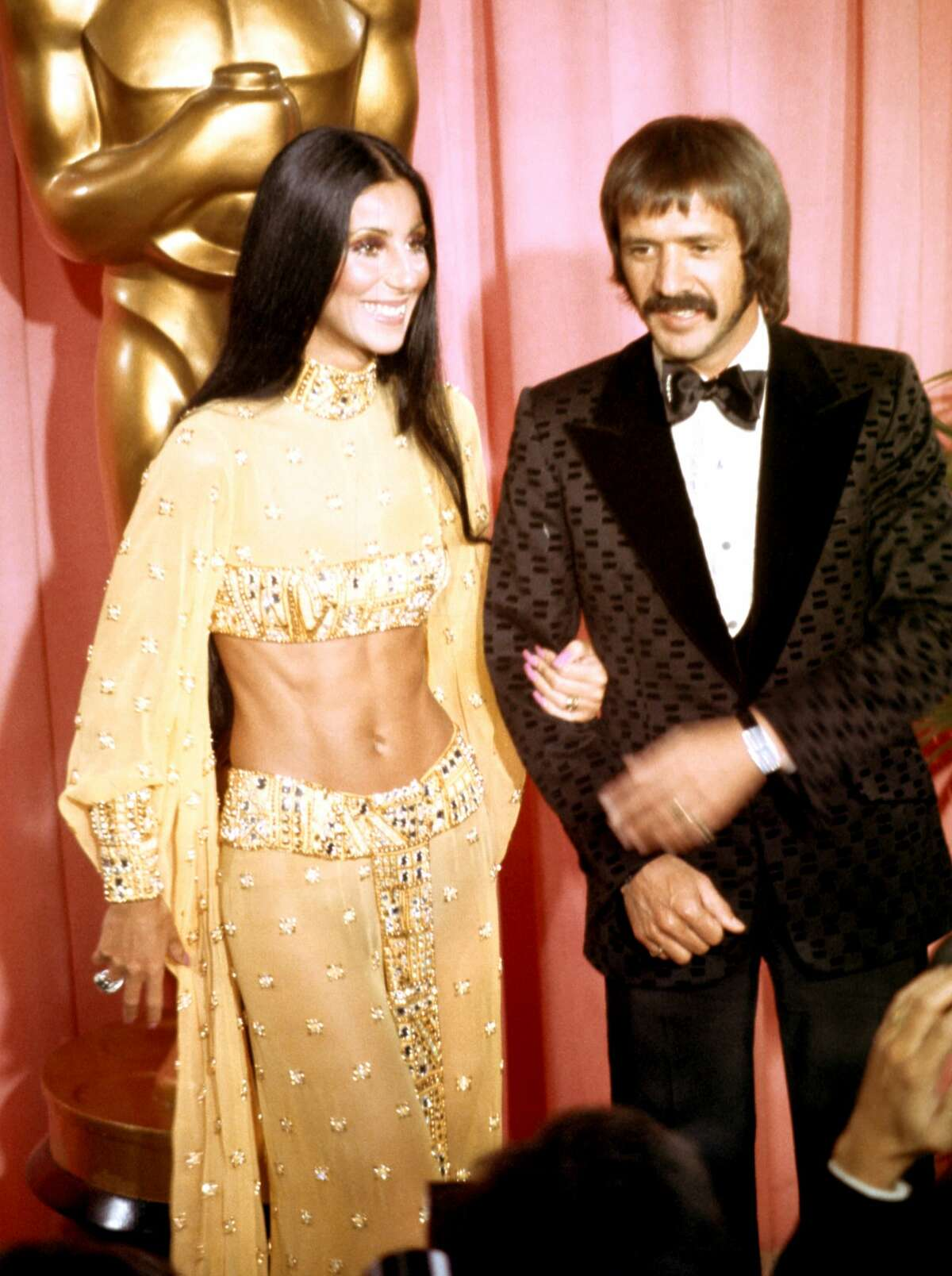 Sonny Bono and Cher attend the Academy Awards ceremony on March 27, 1973. The couple divorced in 1975. Keep clicking to see more throwback couples at the Academy Awards.