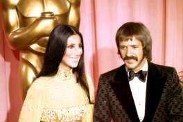 LOS ANGELES - MARCH 27:  Entertainers Sonny Bono and Cher attend the Academy Awards ceremony at the Dorothy Chandler Pavilion on March 27, 1973 in Los Angeles, California. (Photo by Michael Ochs Archives/Getty Images)