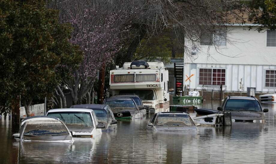 Cars parked on Nordale Avenue remain partially submerged from the Coyote Creek flood in San Jose, Calif. on Wednesday, Feb. 22, 2017. Photo: Paul Chinn, The Chronicle