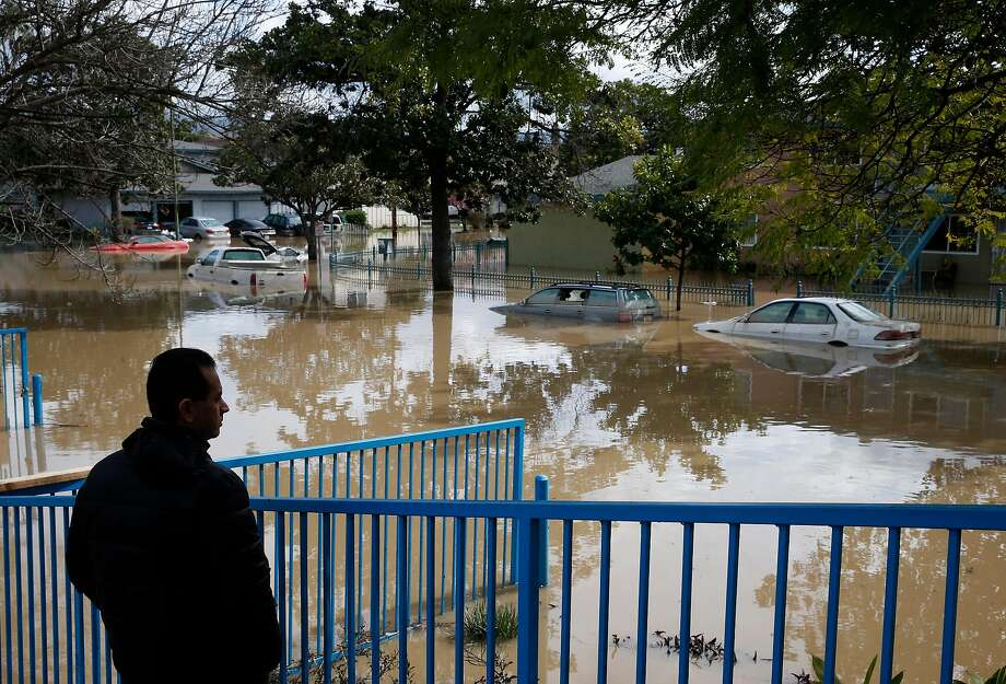 Gelman Ruano surveys the scene on Nordale Avenue from the Coyote Creek flood in San Jose on Wednesday, Feb. 22, 2017. Photo: Paul Chinn, The Chronicle