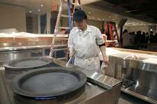 Chef Zhao seasons pans used exclusively for shen ziang pork baos as preparation work is in the final stages at China Live in San Francisco, Calif. on Monday, Feb. 20, 2017. George Chen's ambitious project on Broadway Street includes a tea cafe, restaurants and retail space all under one roof.