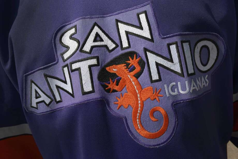 Former star player Dale Henry wears an old San Antonio Iguanas hockey jersey on Oct. 30, 2014. Photo: Billy Calzada /San Antonio Express-News / San Antonio Express-News
