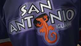 Former Iguanas star Dale Henry wears an old San Antonio Iguanas hockey jersey on Thursday, Oct. 30, 2014.