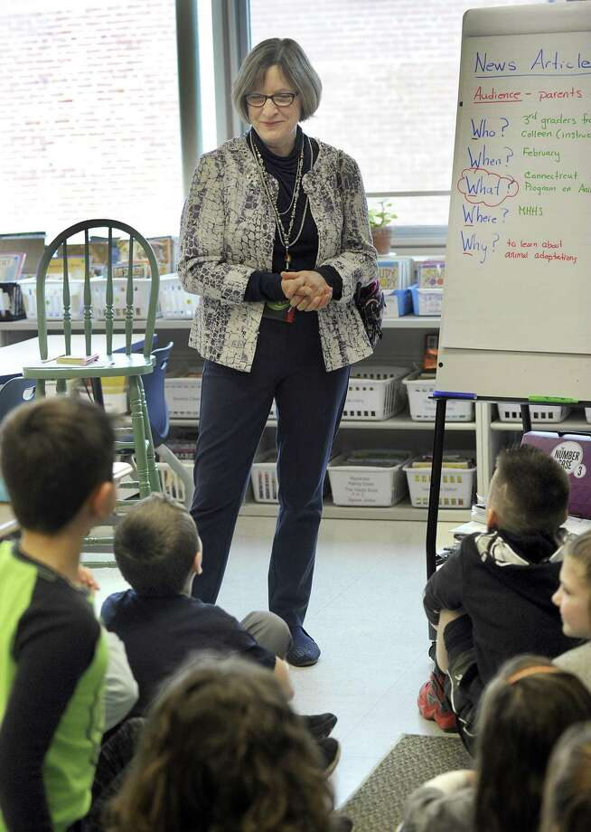Sarah McLain, principal of Meeting House School in New Fairfield, talks to third-graders learning about what makes a news story, Wednesday, February 22, 2017.  McLain has announced plans for retirement at the end of the school year. Photo Wednesday, February 22, 017. Photo: Carol Kaliff / Hearst Connecticut Media / The News-Times