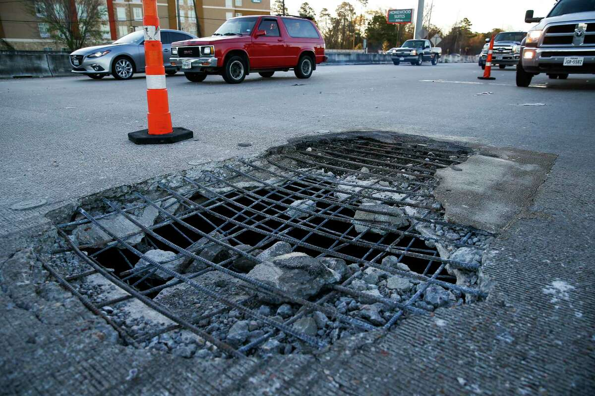 A massive pothole, measuring 10 feet by 7 feet, sits in the middle of I-45 North that has closed all but two lanes just north of the Hardy Toll Road Wednesday, Feb. 22, 2017 in Spring. See the Houston neighborhoods where Houstonians complained about potholes the most >>>