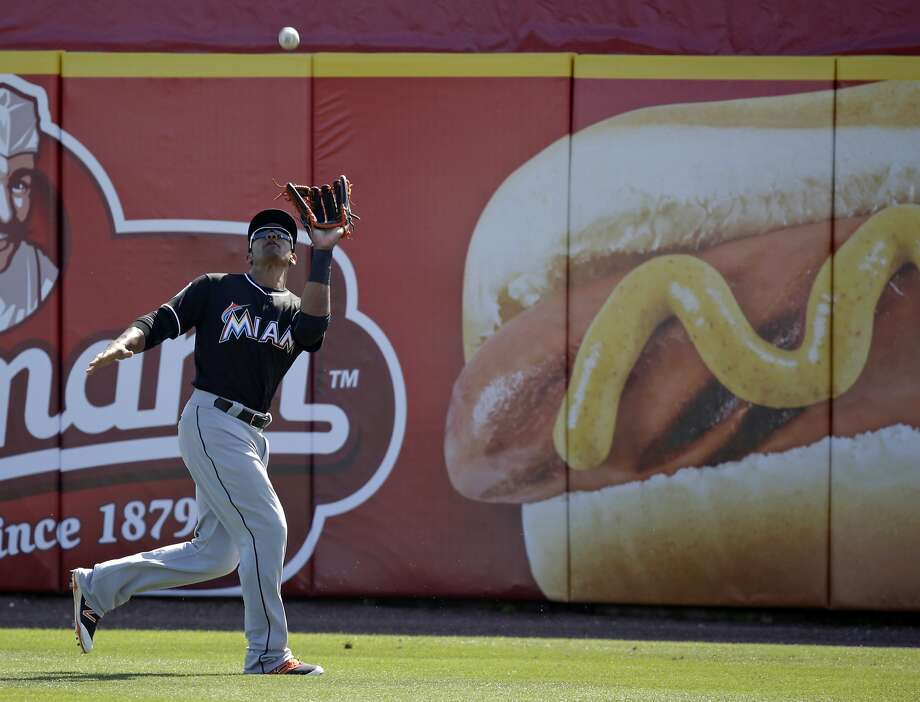 Miami Marlins outfielder Kenny Wilson catches a fly ball in the fifth inning of a spring training baseball game against the Washington Nationals, Monday, March 7, 2016, in Viera, Fla. (AP Photo/John Raoux) Photo: John Raoux, AP