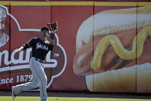 Miami Marlins outfielder Kenny Wilson catches a fly ball in the fifth inning of a spring training baseball game against the Washington Nationals, Monday, March 7, 2016, in Viera, Fla. (AP Photo/John Raoux)