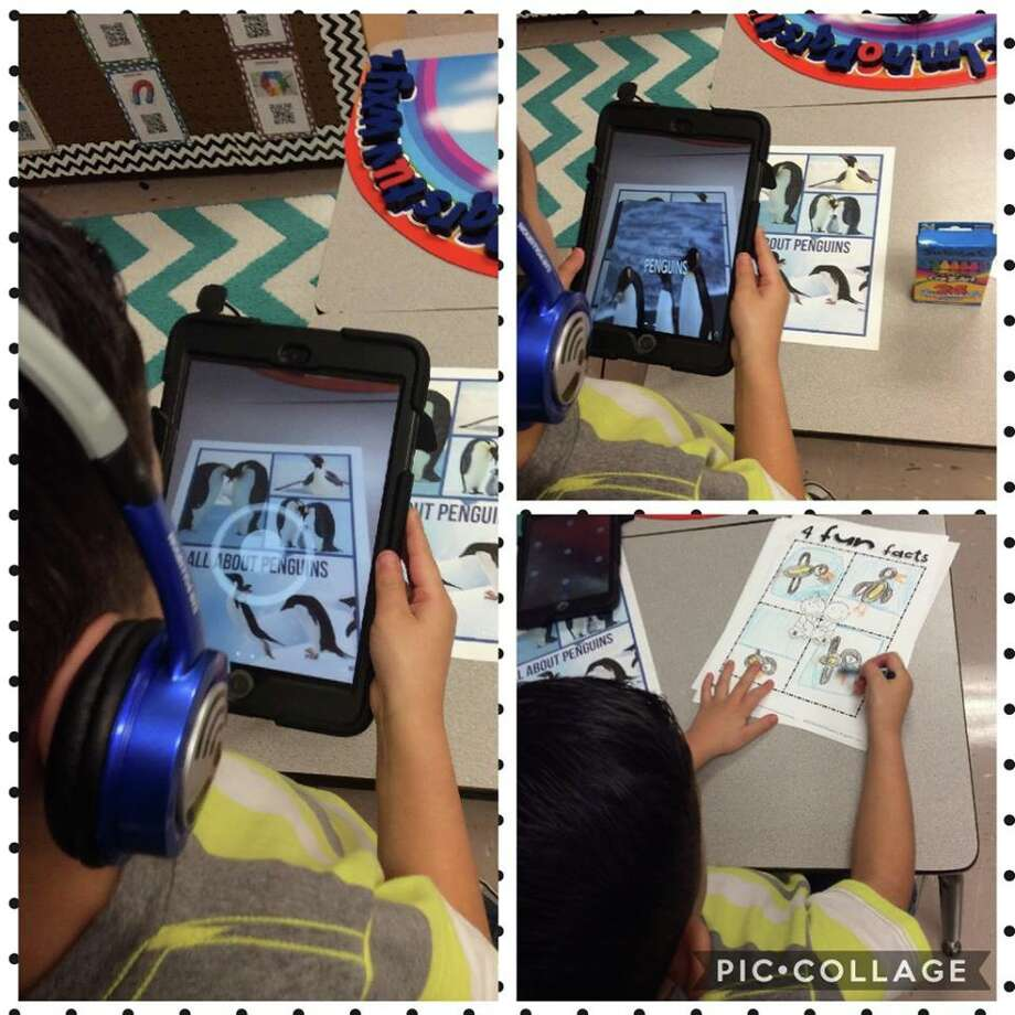 A kindergarten student in Operium Baldwin's class learns about arctic animals through augmented reality, the process of using technology to layer virtual content on top of real-world situations. Photo: Courtesy Photo