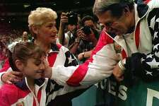 ** ADVANCE FOR WEEKEND EDITIONS JUNE 14-15 ** FILE ** Bela Karolyi, right, congratulates Dominique Moceanu after the United States captured the gold medal in the women's team gymnastics competition as coach Martha Karolyi, left, looks on at the Centennial Summer Olympic Games in Atlanta in this July 23, 1996 photo. In the 2-plus years since she took over as the coordinator of the women's national team, the United States has once again become an international force. And with the Olympics just a year away,Martha Karolyi is finally getting her own due.(AP Photo/Amy Sancetta)  HOUCHRON CAPTION (06/15/2003-2-STAR): Bela Karolyi, right, congratulates Dominique Moceanu after the United States captured the 1996 gold medal in the women's team gymnastics competition. Coach Martha Karolyi was often in the background but was a key part of Team USA's success.