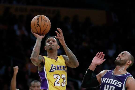The Los Angeles Lakers' Lou Williams is fouled by the Sacramento Kings' Arron Afflalo (40) in the second half at Staples Center in Los Angeles on Tuesday, Feb. 14, 2017. The Kings won, 97-96. (Robert Gauthier/Los Angeles Times/TNS)