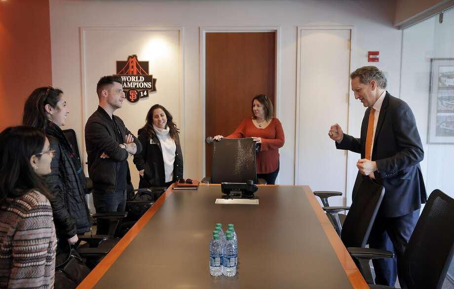 Larry Baer, CEO of the San Francisco Giants, right, stops to have a word with several guests in the Giants offices at AT&T Park in San Francisco, Calif., on Wednesday, February 22, 2017. Photo: Carlos Avila Gonzalez, The Chronicle