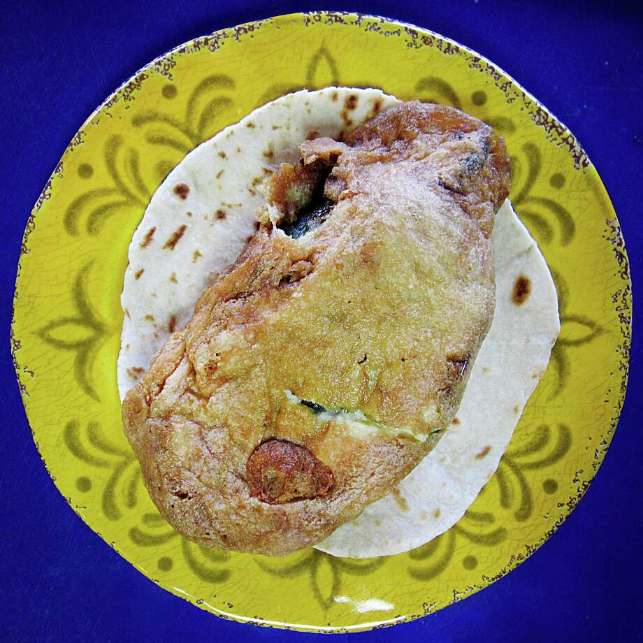 Chile relleno with cheese taco on a handmade flour tortilla from Tacos Martinez on West Commerce Street. Photo: Mike Sutter /San Antonio Express-News