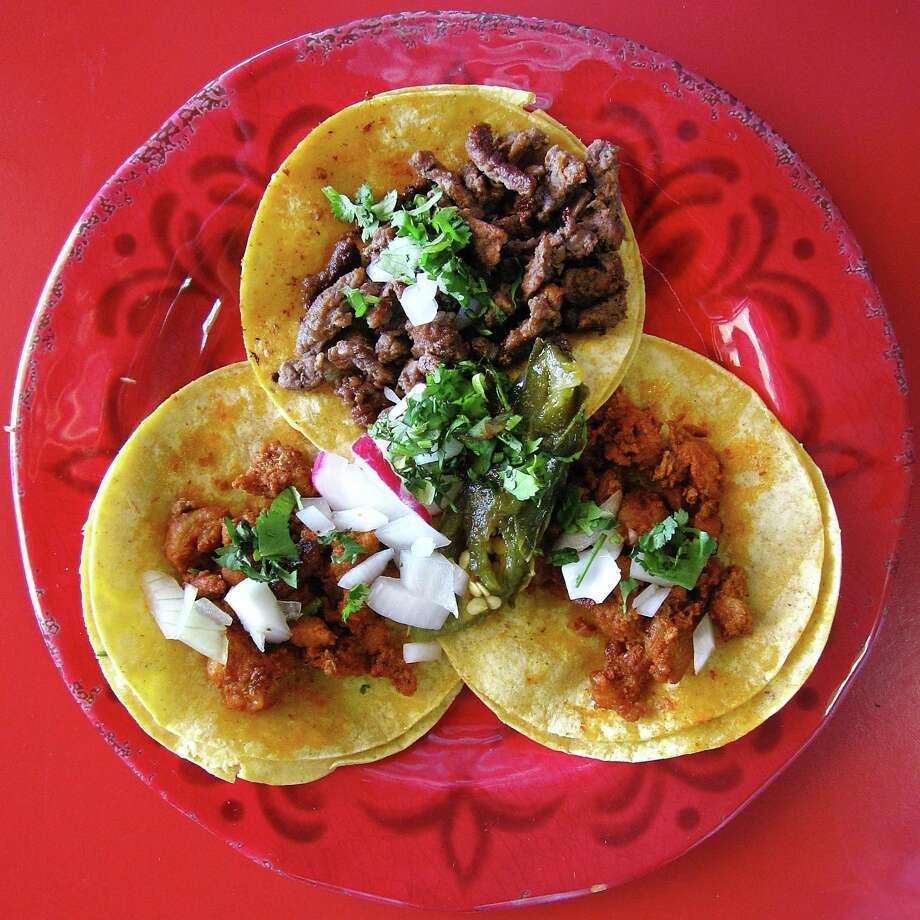 Street tacos with al pastor and carne asada on corn tortillas at Los Cocos Mexican Restaurant on Bandera Road. Photo: Mike Sutter /San Antonio Express-News