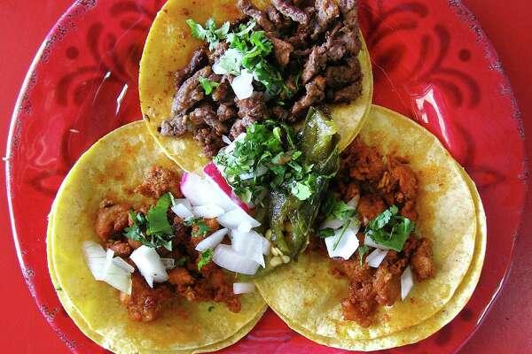 Street tacos with al pastor and carne asada on corn tortillas at Los Cocos Mexican Restaurant on Bandera Road.
