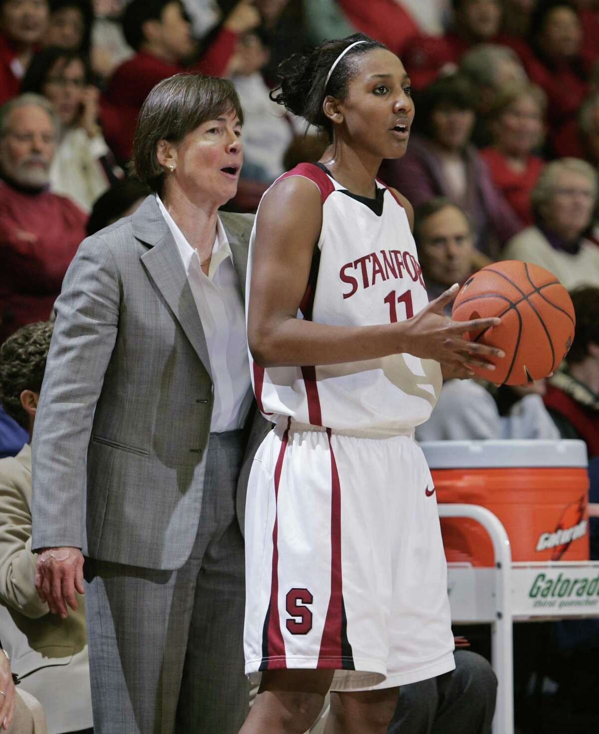 Stanford guard Candice Wiggins (11) listens to head coach Tara VanDerveer, left, in the second half against UCLA during their NCAA basketball game in Stanford, Calif., Saturday, Feb. 2, 2008. Stanford defeated UCLA 75-62. Wiggins was game high scorer with 31 points. (AP Photo/Paul Sakuma)