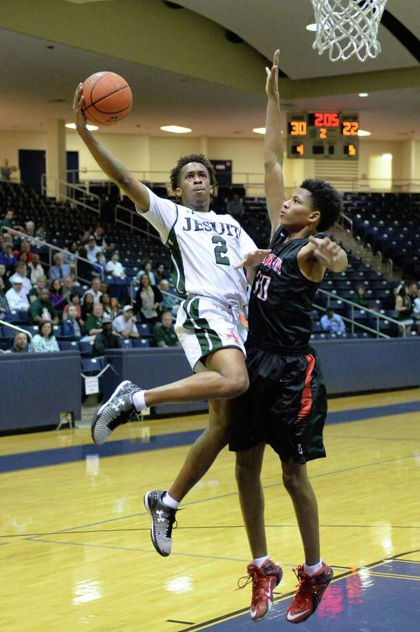 Jordan Pride (2) of Jesuit attempts a shot during the first half of the boy Bi-District playoff game between the Strake Jesuit Crusaders and the Fort Bend Austin Bulldogs on Tuesday February 21, 2017 at the Coleman Coliseum, Houston, TX. Photo: Craig Moseley, Staff / ©2016 Houston Chronicle