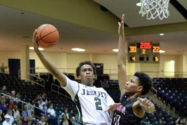 Jordan Pride (2) of Jesuit attempts a shot during the first half of the boy Bi-District playoff game between the Strake Jesuit Crusaders and the Fort Bend Austin Bulldogs on Tuesday February 21, 2017 at the Coleman Coliseum, Houston, TX.