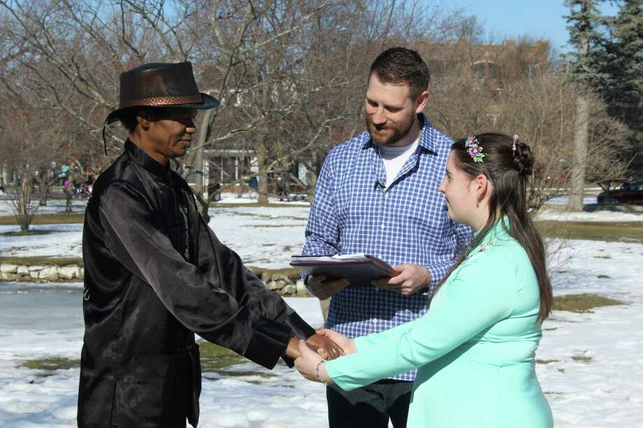 Nick Smith, location pastor of Next Level Church, marries Jeremiah Suggs and Ariana Hayes in Congress Park, Saratoga Springs, N.Y.  on Wednesday, Feb. 22, 2017. (Wendy Liberatore/Times Union)