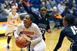 Gabby Connally blows through the defense as Brandeis plays Steele in class 6A third round playoff action at UTSA on February 21, 2017. (Staff photo)