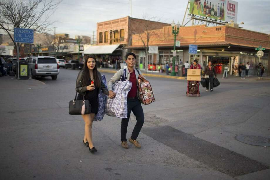 Valerie Padilla and Diego Munoz, both 16, cross from El Paso into Ciudad Juarez for the weekend to see relatives. MUST CREDIT: Photo by Ivan Pierre Aguirre for The Washington Post Photo: For The Washington Post / For The Washington Post / For The Washington Post