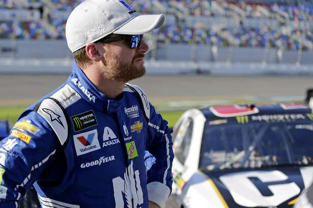 Dale Earnhardt Jr. stands on pit road after his qualifying run for the NASCAR Daytona 500 auto race at Daytona International Speedway, Sunday, Feb. 19, 2017, in Daytona Beach, Fla. Earnhardt Jr. will start the race in the No. 2 position. (AP Photo/Terry Renna)
