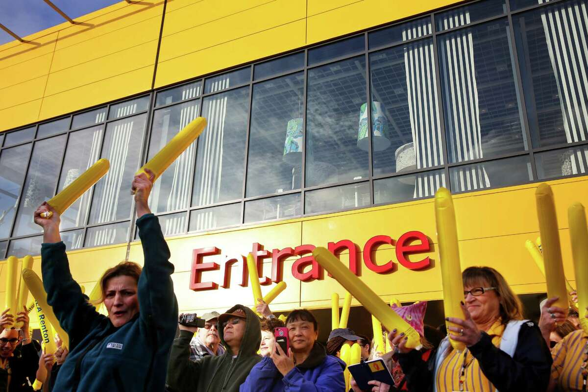 Ikea co-workers cheer during an opening ceremony for the new IKEA store in Renton, Feb. 22, 2017.